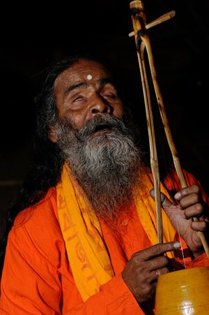 Blind Baul Kanai Das sings to the sound of his ektara.  For the Baul, the human body is God's abode and his temple.
