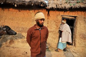 Peasants in the village of Lohagarh in West Bengal.  With their roots in the Bengali village, the Bauls' message is often expressed in simple language, and using village metaphors understandable to the peasant.