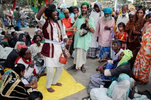 Bauls at a village festival in Pathacharpuri, West Bengal.  In the past Bauls lived on the alms they received singing in villages.  However, today the alms system has broken down, and most Bauls sustain themselves by singing at village fairs and festivals.  Some also perform at concerts and make recordings.