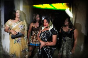 Hijras in front of a bar waiting for clients.