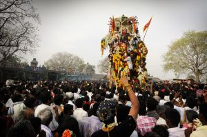 After a few days' partying and working in Villupuram, on a date determined by astrologers, the hijras proceed to the small village of Koovagam for their ritual wedding with the Hindu god Aravan, whose effigy, garlanded with flowers, is paraded around the village.