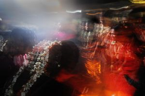 At night hijras celebrate their wedding, with dancing in front of the temple and later with an orgy that takes place in the dark fields surrounding the village.