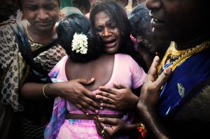 Hijras cry for the god Aravan - their departed husband.