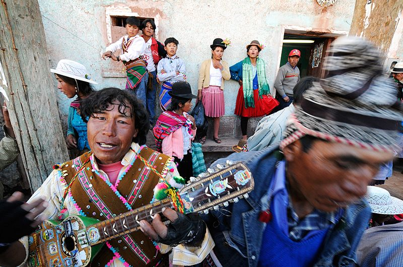 <b>El Charangueiro</b> - After the air clears of tear gas people return to the square to play music, dance and drink chicha.