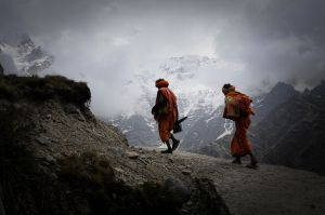 Hindu ascetics walk to a pilgrimage site in the Indian Himalaya.