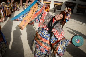 A Buddhist monk in Ladakh performs a sacred dance.