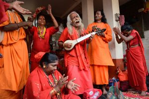 Pilgrims in a temple in Assam singing as an offering to the Mother Goddess.