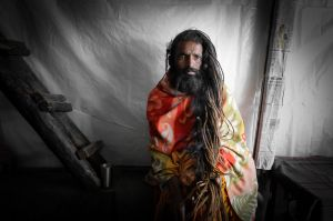 A Hindu ascetic rests in a tea shop during a pilgrimage in the Himalaya.