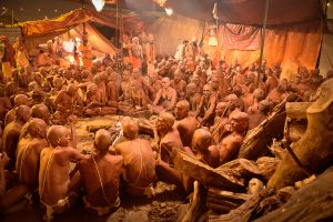 New inductees into a Hindu order of ascetics undergoing an initiation ritual in Allahabad.