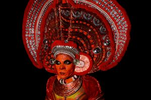 A man in Kerala possessed by a god, known as a Theyyam.