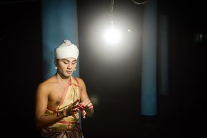 A Vaishnavite monk prepares to perform in a sacred drama in a monastery on the island of Majuli.