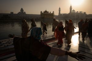 A pilgrim greets the sunrise at the Golden Temple, the most sacred site of India's Sikhs.