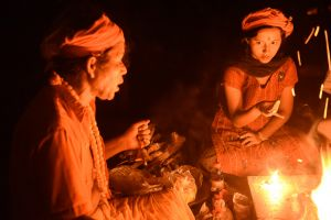 A woman and a priest perform a Tantric ritual in West Bengal.