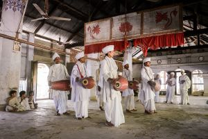 Vaishnavite priests perform a sacred dance in a monastery temple on the island of Majuli in Assam.