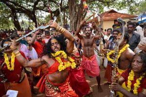 An oracle possessed by the Mother Goddess dances during a ritual in Kerala.