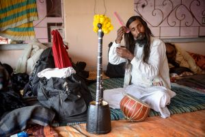 A Bangladeshi Baul get dressed before singing. For Bauls music and song constitute a form of meditation and prayer.