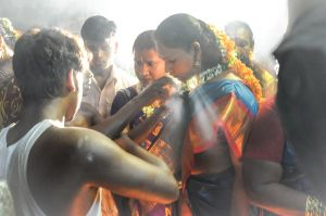 Hijras, sacred female men, during their ritual wedding with a Hindu god in Tamil Nadu.