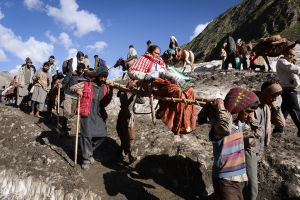 In the Kashmir Himalaya Hindus travel for three days to reach a sacred cave.
