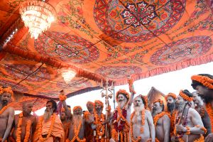 Sadhus, Hindu ascetics, get ready to proceed to a ritual bath in the sacred waters of the Ganges near Allahabad.