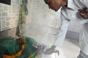 A Sidi performs a ritual at a shrine to the saint Bhava Gor, the most revered of the Sidis' saints.