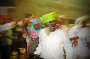 A couple possessed by the spirit of a Sidi saint dance at a Sidi Dhammal.