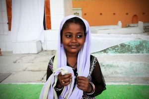 A Sidi girl with a bandaged finger.