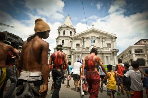 Their backs bloodied by hours of self-flagellation, penitents arrive at San Fernando's Cathedral to pray.