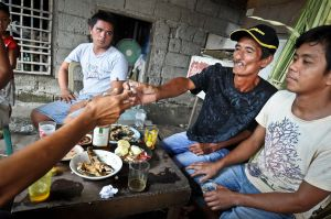 Alfredo, a house painter, shares a meal, a drink and a cigarette with some friends before he is nailed to a cross.