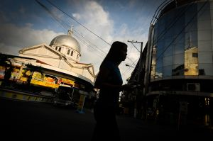A woman walks past the Metropolitan Cathedral in the northern city of San Fernando.