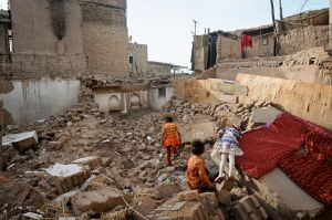 Children play in the ruins of the old city