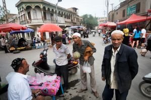 Haggling over a melon in Kashgar