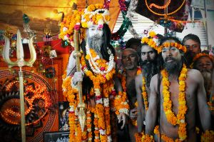 Naked ascetics of Juna Akhara prepared for their procession to bathe in the Ganges River, a spiritual Crossing