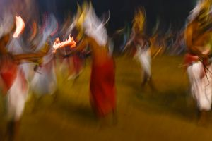 Entranced men possessed by nature spirits dance in front of the Bhadrakali temple in Kadammanitta.