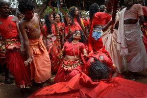 Entranced oracles dance in frenzy and ecstasy and throw themselves on the ground before the Godess' temple during the Bharani, a ritual which aims to propitiate the bloodthirsty goddess Sri Kurumba, or Kali, and obtain her blessings as the engenderer and protector of life.