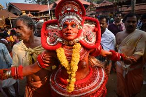 A masked dancer possessed by the Goddess known as Sri Kurumba or Kali.