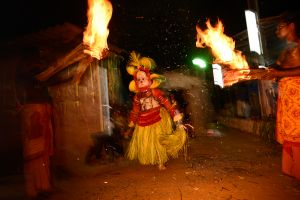 Theyyam: a man possessed by a god.