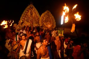 A procession escorting the gods to the Mother Goddess temple, where the Padayani ritual will take place.