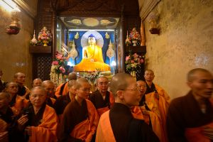 Nuns inside the sanctum sanctorum of the Buddhist temple at Bodhgaya. The statue of a meditating Gautama dates to the 10th century AD.