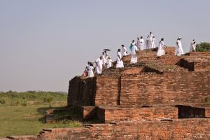 Sri Lankan pilgrims on the ruins of a stupa commemorating one of the Buddha's important disciples, Anathapindika. It is one of the few remains of the great ancient city of Sravasti.
