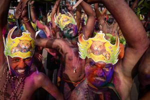 Half naked and smeared in paint, Hindu pilgrims dance in front of the Vavar Mosque in the south Indian town of Erumeli at the start of their pilgrimage to Sabarimala, the mountain shrine of the god Ayyappa.