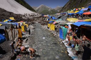 Men bathe in an icy mountain stream outside the Amarnath Cave in order ritually to purify themselves.