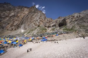 After walking for three days, pilgrims arrive at the the Amarnath Cave, a vast womblike opening in a cliff, high in the Kashmir Himalaya. Inside the cave stands a giant ice stalagmite, said to be a manifestation of the god Shiva as ice.