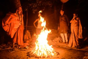 At a ceremony in a cremation ground, a Tantric priest calls out to the mother goddess.