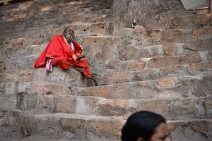A holy man praying and meditating outside the Kamakhya temple.