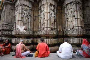 Devotees sit in meditation and prayer outside the Kamakhya temple.
