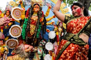 A devotee in Calcutta dances before an image of the goddess Durga.