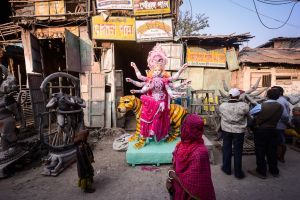 An image of the goddess Durga stands outside an idol workshop in Calcutta.