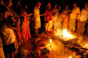 A Tantric priest leads people in a a ritual of offerings to the mother goddess.