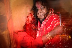 An entranced woman possessed by the goddess during a Tantric ritual.