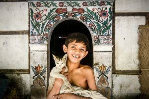 One of the monastery cats and a young monk.